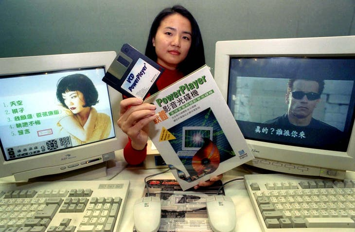 A PROMOTION WOMAN DISPLAYS A SOFTWARE FOR PLAYING VCD